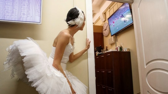 Soccer Football - World Cup - Quarter-final - Russia vs Croatia - Saint Petersburg, Russia - July 7, 2018 - A ballerina watches the broadcast of the World Cup quarter-final match between Russia and Croatia at the Mikhailovsky Theatre. REUTERS/Anton Vaganov     TPX IMAGES OF THE DAY - RC1831117510