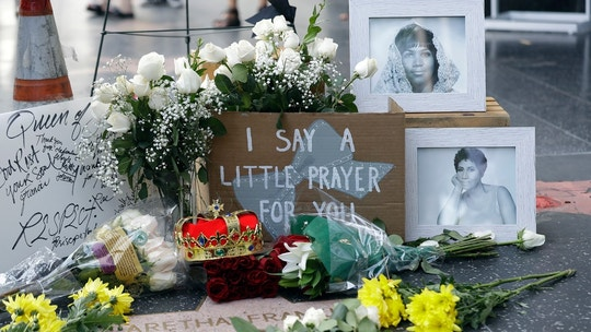 Flowers and signs are placed on Aretha Franklin's star at the Hollywood Walk of Fame Thursday, Aug. 16, 2018, in Los Angeles. Franklin died Thursday at 76. She was born and rose to fame during the segregation era and went on to sing at the inauguration of the first black president, often used her talent, fortune and platform to inspire millions of black Americans and support the fight for racial equality.(AP Photo/Marcio Jose Sanchez)