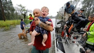 Oliver Kelly, 1 year old, cries as he is carried off the sheriff's airboat during his rescue from rising flood waters in the aftermath of Hurricane Florence in Leland, North Carolina, U.S., September 16, 2018. REUTERS/Jonathan Drake - RC12A6FCD480