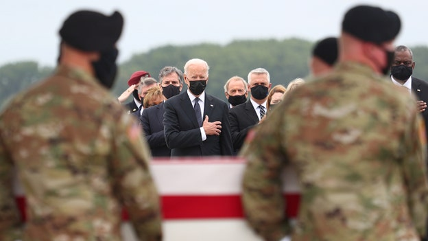 President Biden receives bodies of fallen troops at Dover Air Force Base