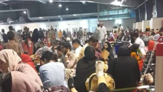 Crowded conditions as evacuees processed in Qatar