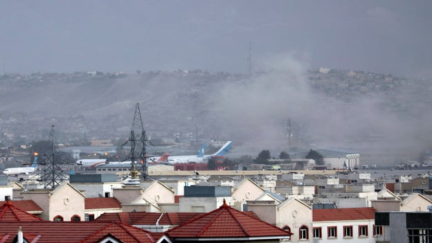 Photo shows smoke rising from Kabul airport following explosion