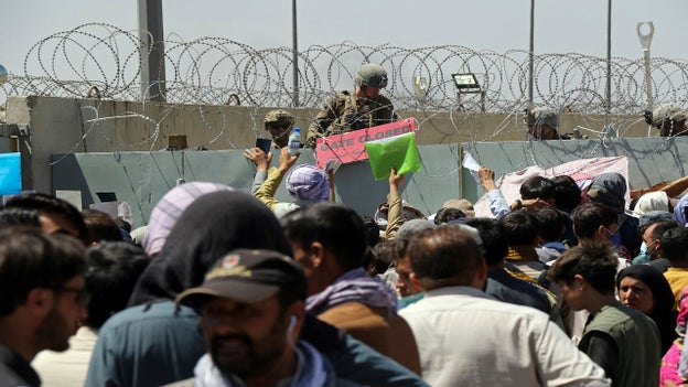 Photo shows Kabul airport gate being closed