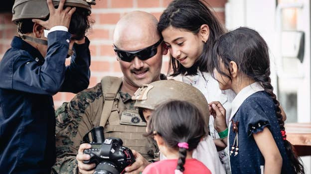 U.S. Marine interacts with Afghan children