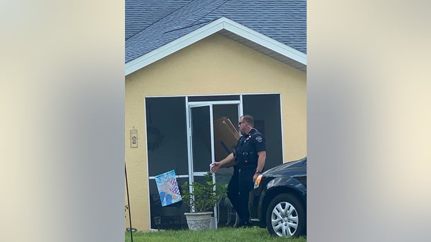 Police drop cardboard boxes off at Laundrie home