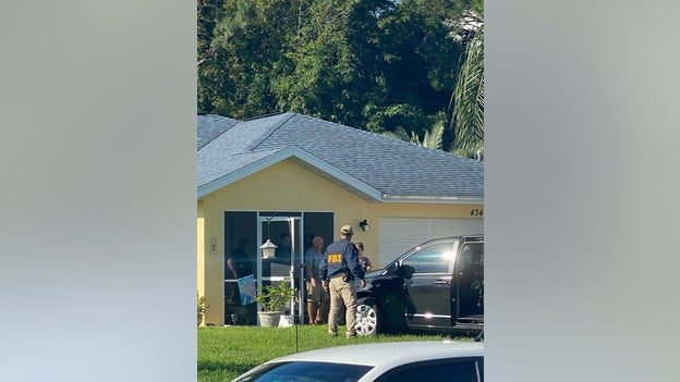 PHOTO: Chris Laundrie being led out of the property