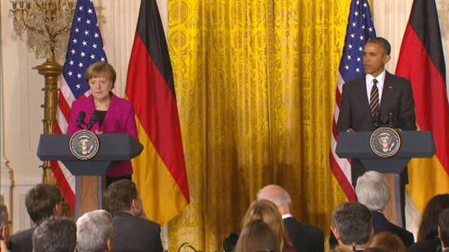 President Obama meets with German Chancellor Merkel amid global tension