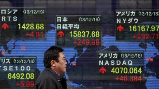 Asian shares mixed after weak China data