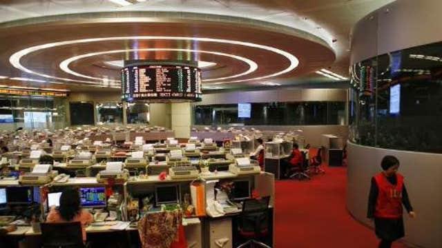 Asian shares mixed, Shanghai gains