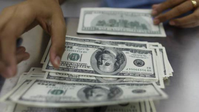 How can investors gain from the strong dollar?