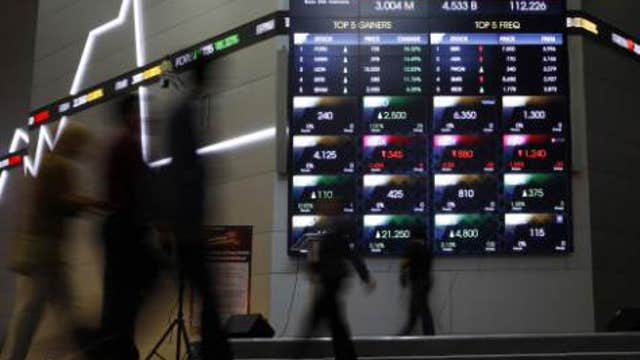 Asian markets close mostly higher