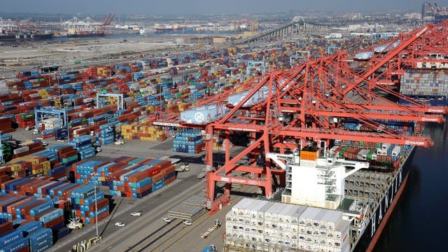 What is keeping the West Coast port dispute going?