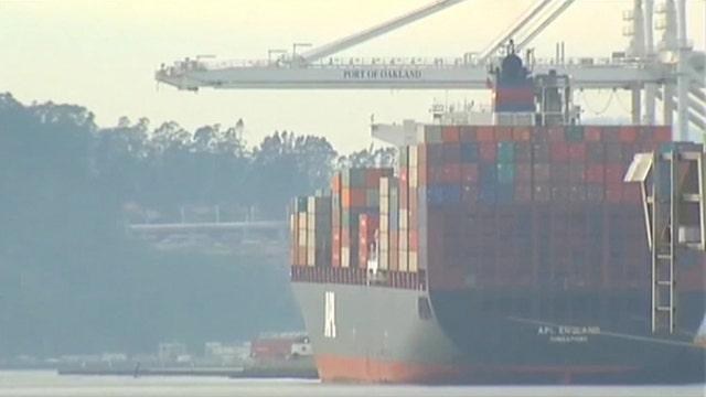 West Coast port shutdown, winter weather weigh on economy