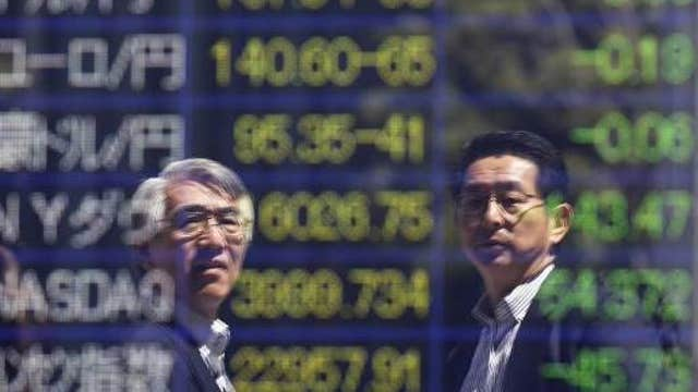 Asian shares mostly higher, Nikkei falls
