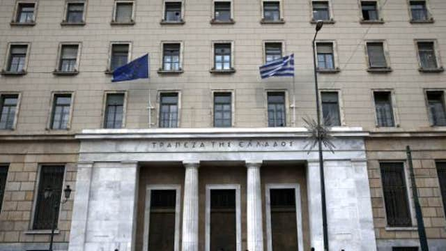 How can Greece's debt crisis be resolved?