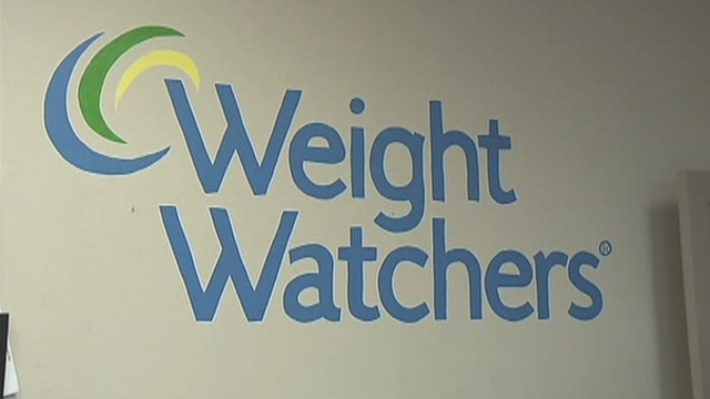 Weight Watchers shares hit record low