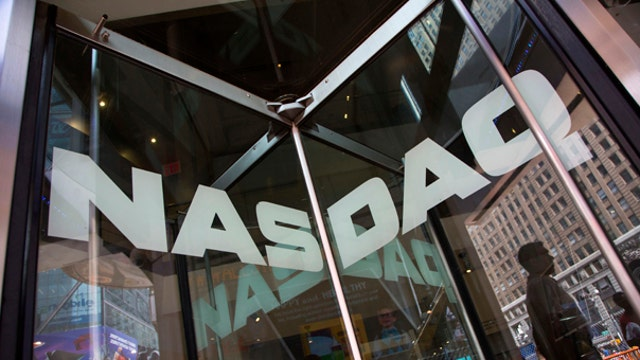 Nasdaq closes above 5K for first time since March 2000