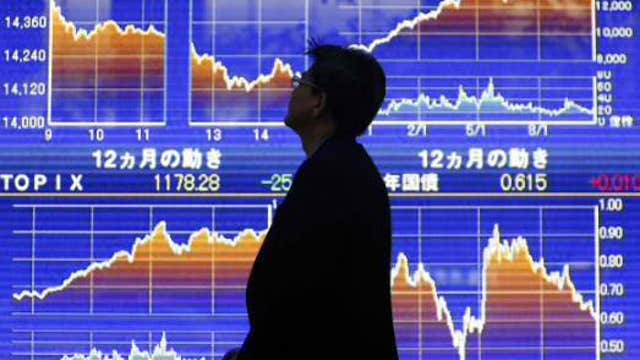 Asian shares mostly lower, Shanghai gains