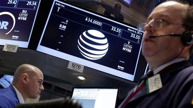 Dow kicks out AT&T and puts Apple in