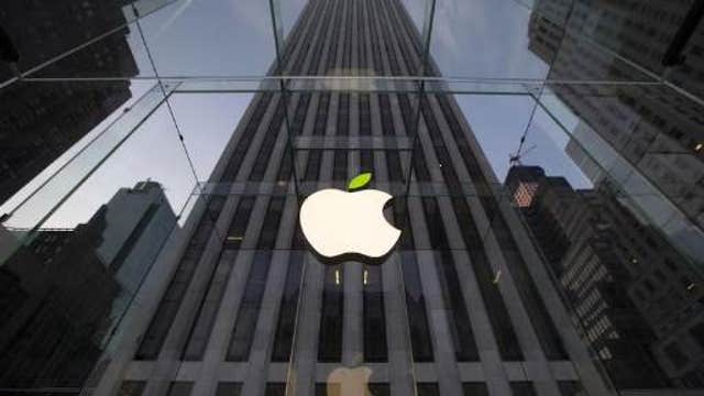 Apple replaces AT&T in the Dow Industrials