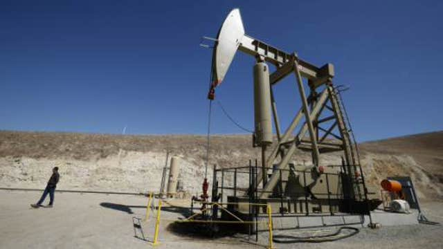 Oil touches six-year low