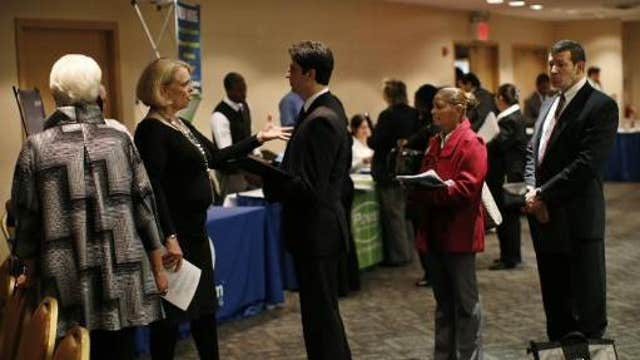 Weekly jobless claims rise to 291,000