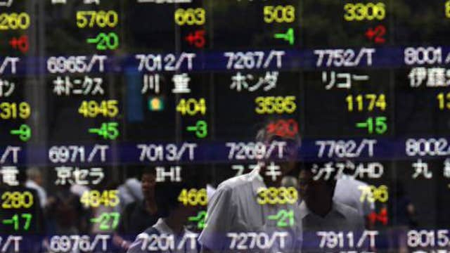 Asian markets close trading week mixed
