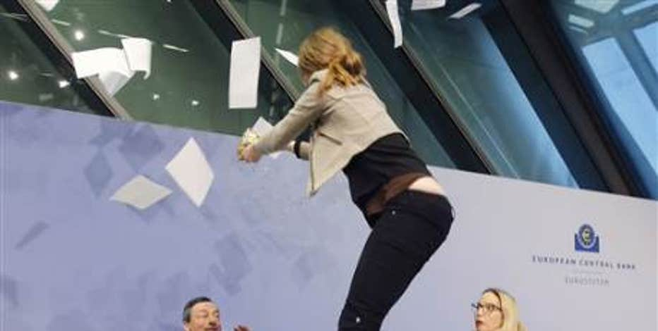 An anti-ECB protester charged the stage during Draghi's press conference shouting 'end ECB dictatorship.'