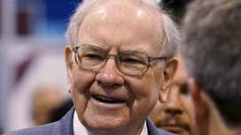 Warren Buffett walks the exhibition floor at Berkshire's annual meeting