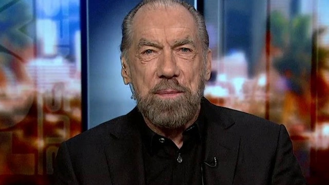 Paul Mitchell Co-Founder John Paul DeJoria on the steps to improving the economic environment for business, Anheuser-Busch InBev's deal for SABMiller, the latest consumer trends and Benghazi.