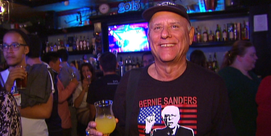 "Supporters gather to drink a ""Beer for Bernie"" and watch the first Democratic debate."