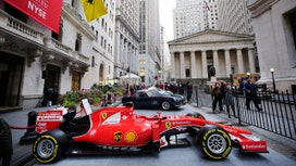 Ferrari zooms higher in market debut, closes nearly 6% above IPO price