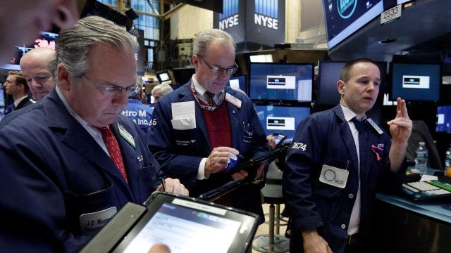 U.S. stocks close higher, Nasdaq ends losing streak