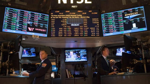Dow closes higher as oil prices rebound