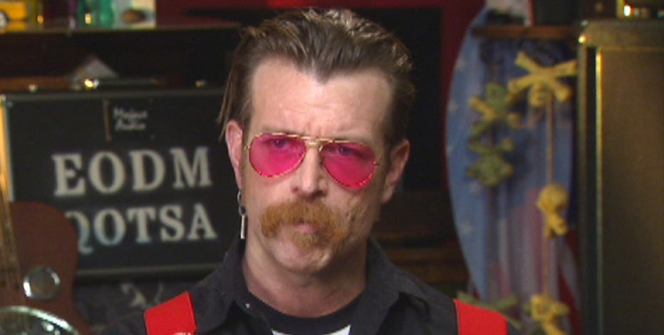 Kennedy discusses security with the Eagles of Death Metal lead singer Jessie Hughes.