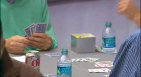 Buffett, Gates compete in a game of bridge