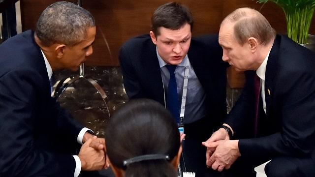 Obama talks to Putin in Paris