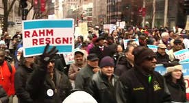 Demonstrators hold Christmas Eve protest on Chicago's Michigan Ave.