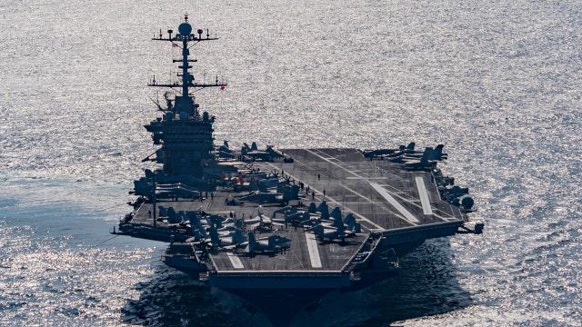 Iran fires rockets near U.S. aircraft carrier