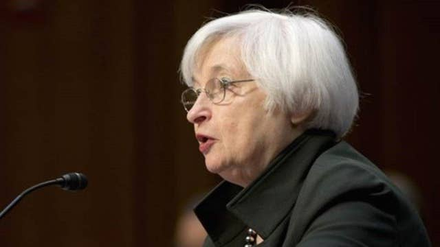 Fed weighs ISIS, oil drop