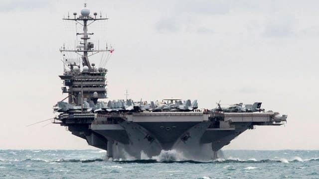 Iran launches rocket near U.S. warship