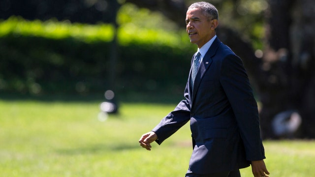 Obama uses executive order to challenge immigration
