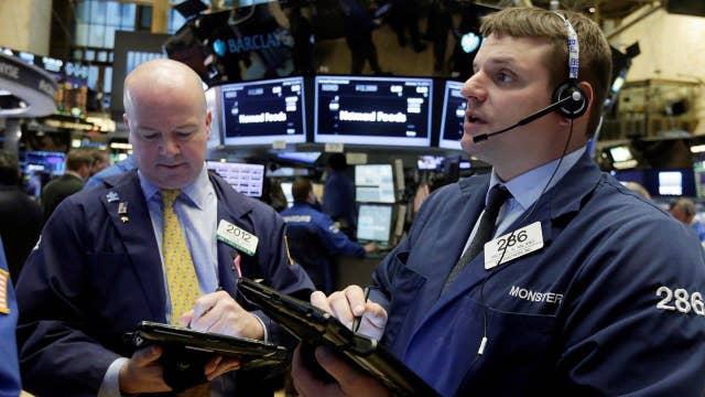 U.S. stocks slide, Brent crude dips below $30