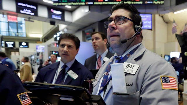 Dow dives, trims losses with late rally