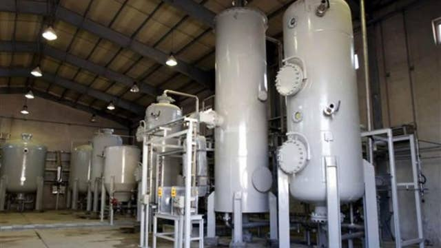U.S.: Concrete poured into core of Iran Arak reactor