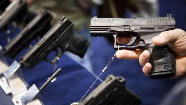 Newtown teacher arrested for having gun at school