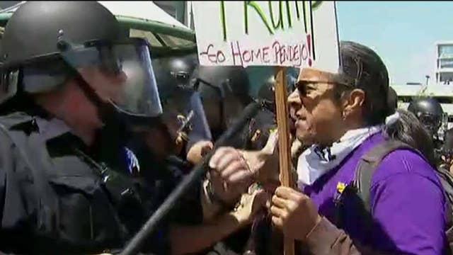 Trump protestors break through barricades