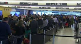 Why long lines plague air travelers
