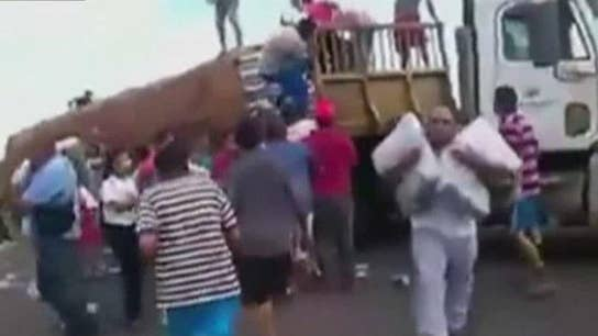 Exclusive: Harrowing Video Shows Starving Venezuelans Eating Garbage, Looting