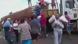 Exclusive: Graphic video shows Venezuelans looting, eating garbage